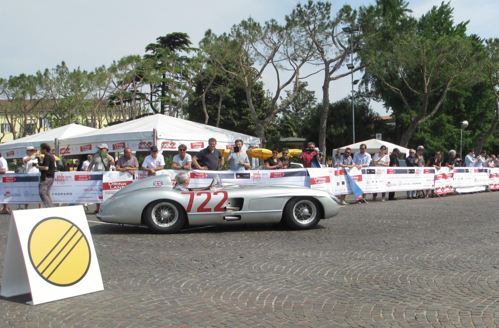 Sterling driving 722 on the 60th anniversary leaving the check point at Sirmione